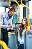 Woman in bus having no valid ticket at inspection Royalty Free Stock Photography