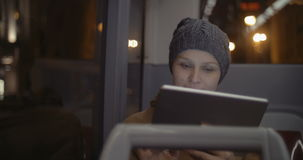 Woman in the bus using tablet computer stock footage