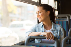 Woman bus work. Beautiful young woman taking bus to work Stock Photo