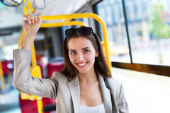 Woman on bus. Young woman smiling on bus royalty free stock photos