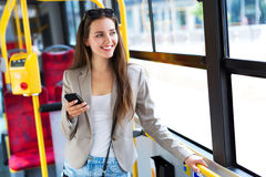 Woman on bus. Young woman smiling on bus royalty free stock image