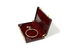 Woman in business. Burgandy leather Briefcase used to carry items to the office with large gold earring Royalty Free Stock Image