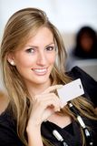 Woman with a business card Royalty Free Stock Photography