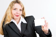 A woman with a business card stock image