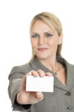 Woman with business card. A business woman showing her black business card isolated on white.  Focus on the business card Stock Image