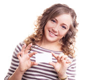 Woman with a business card. Beautiful young blond curly woman with a business card Royalty Free Stock Photography
