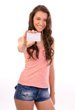 Woman with business card. Teen girl holding blank sign, full length isolated on white background Stock Images