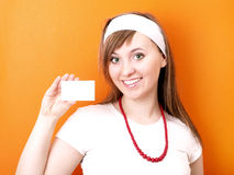 Woman with business card Royalty Free Stock Images