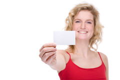 Woman with business card. Full isolated portrait of a beautiful  caucasian woman with a blank business card Stock Photo