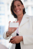 Woman with business card across office Royalty Free Stock Photo