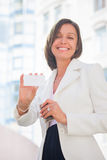 Woman with business card across office Stock Photo