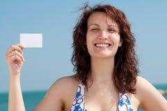 Woman with Business Card on a Beach Stock Photos