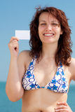 Woman with Business Card on a Beach Stock Image