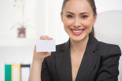 Woman with business card. Royalty Free Stock Images