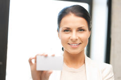 Woman with business card. Bright picture of confident woman with business card Stock Photo