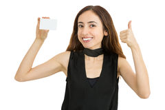 Woman with business card giving thumbs up. Friendly caucasian woman giving thumbs up and showing business card with copy space. Isolated on white background Royalty Free Stock Images
