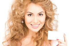 Woman with business card. Happy woman with business card over whiter Stock Images