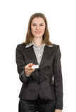Woman with a business card. Isolated on white Royalty Free Stock Photo