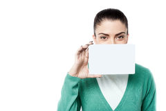 Woman with business card over white. Young woman showing blank white card Royalty Free Stock Photo
