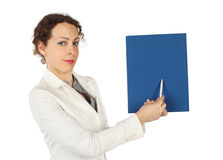 Woman in business dress, pointing on blue folder Stock Photography
