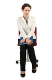 Woman in business dress sitting on chair and ho Royalty Free Stock Photography