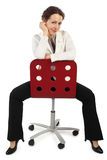 Woman in business dress sitting on red chair Stock Photography