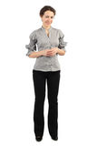 Woman in business dress standing and smiling Royalty Free Stock Photos