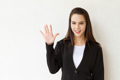 Woman business executive showing 5 or five fingers hand gesture. On plain background with space for text or copy Royalty Free Stock Photography