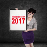 Woman with business goals for 2017 on board Stock Images