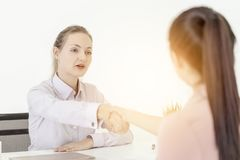 Woman business congratulate co worker for success job interview royalty free stock images