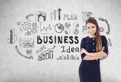 Woman, business idea, concrete wall Royalty Free Stock Image