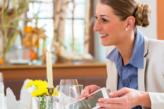 Woman in business lunch with tablet computer Royalty Free Stock Photos