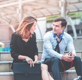 Woman with business man couple lover talking flirting sitting outdoor stock photo