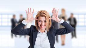 Woman business manager acting funny and childish Royalty Free Stock Photos