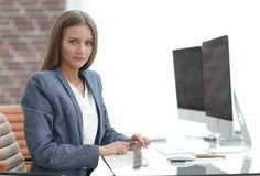 Woman business Manager working at a computer Royalty Free Stock Images