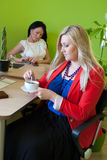 Woman business office drink coffee break. Work two Royalty Free Stock Image