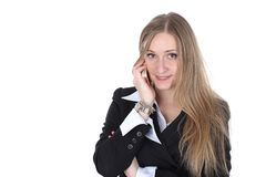 Woman in business outfit talking to mobile Royalty Free Stock Images