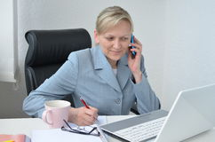 Woman, business plan. Woman in office, working on business plan Stock Photos