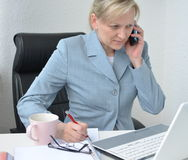 Woman, business plan. Woman in office, working on business plan Royalty Free Stock Photos