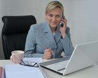 Woman, business plan. Woman in office, working on business plan Stock Photo