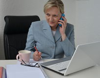 Woman, business plan. Woman in office, working on business plan Royalty Free Stock Images