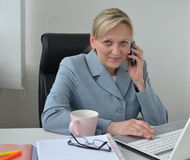 Woman, business plan. Woman in office, working on business plan Royalty Free Stock Photo