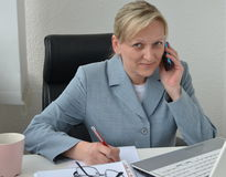 Woman, business plan. Woman in office, working on business plan Stock Images