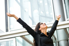 Woman business success. Business female executive success. Successful and blissful woman outside corporate building. Successful and happy hispanic brunette Royalty Free Stock Image