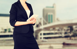 Woman in business suit on a city building background. filtered image Stock Images