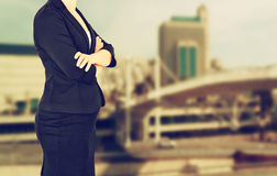 Woman in business suit on a city building background. filtered image Stock Image