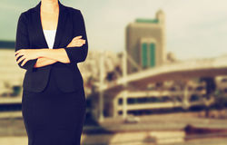 Woman in business suit on a city building background. filtered image. Royalty Free Stock Photo