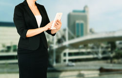 Woman in business suit on a city building background. filtered image Royalty Free Stock Images