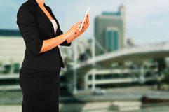 Woman in business suit on a city building background. filtered image. Stock Photography