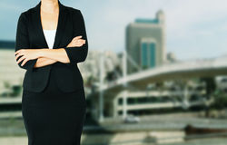 Woman in business suit on a city building background. filtered image Stock Photography